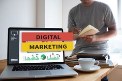 DIGITAL MARKETING new startup project MILLENNIALS Business team. Hands at work with financial reports and a laptop royalty free stock photos