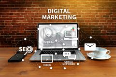 DIGITAL MARKETING new startup project MILLENNIALS Business team. Hands at work with financial reports and a laptop stock photography