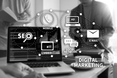 DIGITAL MARKETING new startup project MILLENNIALS Business team. Hands at work with financial reports and a laptop royalty free stock images
