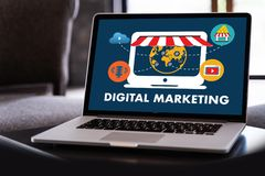 DIGITAL MARKETING new startup project MILLENNIALS Business team. Hands at work with financial reports and a laptop royalty free stock image