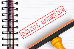 Digital marketing rubber stamp on the note book Stock Image
