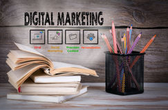 Digital Marketing. Stack of books and pencils on the wooden table. Stock Images