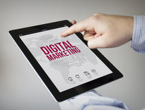 Digital marketing on a tablet Stock Images