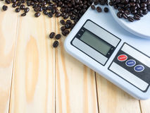 Digital measuring device and coffee beans Stock Photo