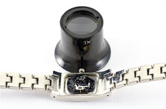 Digital mechanism of a watch and loupe Stock Images