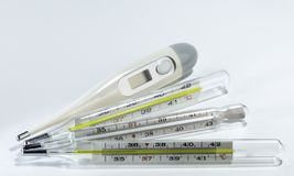 Digital and mercury medical thermometers on neutral background stock photos