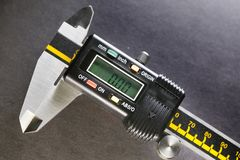 Digital micrometer industrial still life on a black background Royalty Free Stock Images