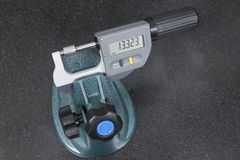 Digital micrometer measurement a pivot bearing probe. On granite table Stock Images
