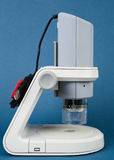 Digital microscope on blue background Stock Photos