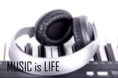 Digital midi keyboard and headphones (blured) Stock Photo