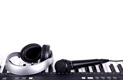 Digital midi keyboard and headphones Stock Photos