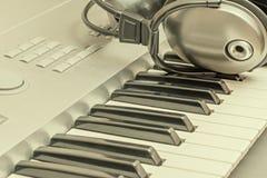 Digital midi keyboard and headphones. Royalty Free Stock Photos