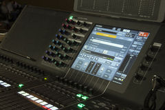 Digital mixing console. Side view of a mixing console Stock Image
