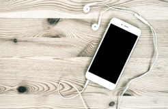 Digital mobile phone with headphones Royalty Free Stock Image