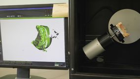 Digital modeling of dental implants in modern medical laboratory and shows on computer screen. Close-up stock video footage
