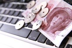 Digital money. Norwegian currency on a black laptop keyboard Stock Photo