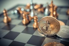 Digital money Concept. Bitcoin on chess board game of business ideas royalty free stock photography
