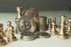Bitcoin on chess board game of business ideas royalty free stock image