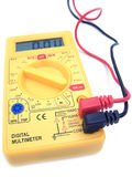 Digital Multimeter 01. A yellow multimeter with corresponding probes royalty free stock photo