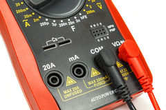 Digital multimeter with attached probes closeup on white background Royalty Free Stock Photos
