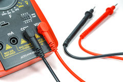 Digital multimeter with attached probes on a white background Royalty Free Stock Photo