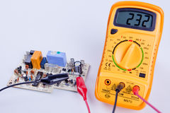 Digital multimeter with board Royalty Free Stock Photo