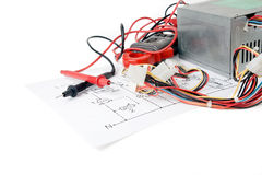 Digital multimeter and the circuit. Repair of electronic devices Stock Photo