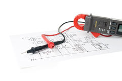 Digital multimeter and the circuit. Stock Photography