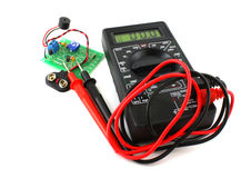 Digital multimeter and circuit board Royalty Free Stock Images