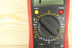 Digital multimeter closeup on a wooden table stock photos