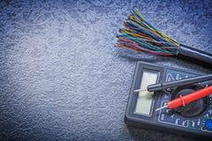 Digital multimeter electric tester wires on black background ele Stock Images