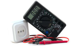 Digital  multimeter with electrical outlet Stock Photos