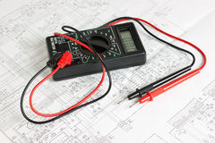 Digital multimeter and an electronic circuit Royalty Free Stock Photo