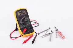 Digital multimeter and hand tools Stock Photo