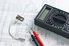 Digital multimeter and  lamp Royalty Free Stock Photos
