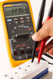 Digital multimeter measuring voltage Stock Photo