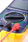 Digital Multimeter. Modern digital multimeter on a white background, shallow depth of field stock photography