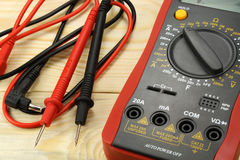 Digital multimeter with probe on a wooden table stock photos