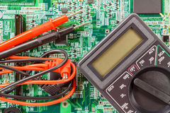 Digital multimeter with probes on a printed circuit board Stock Images