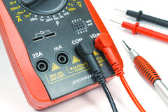 Digital multimeter with probes and screwdriver on white background Stock Photos