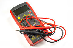 Digital multimeter with probes on a white background Royalty Free Stock Photo
