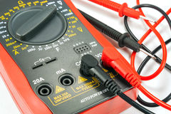 Digital multimeter with probes on a white background Stock Photo