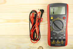 Digital multimeter with probes on a wooden table Stock Photography