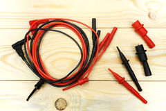 Digital multimeter probes on a wooden table Royalty Free Stock Photo