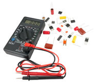 Digital multimeter and Radio components Royalty Free Stock Photo