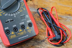 Digital multimeter and set of probes on a table in a workshop Stock Photos