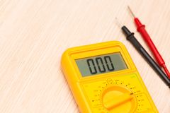 Digital multimeter on a table close up image stock photos