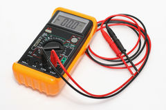 Digital multimeter with testing leads. Picture of a digital multimeter with testing leads Royalty Free Stock Photo