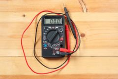 Digital multimeter and wiring on wooden table. special tools of technician for work with circuit and electrical. technician use stock images