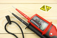 Digital multimeter on a wooden table stock photos